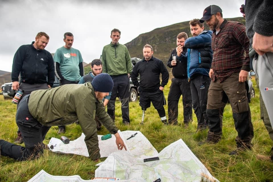 Route briefing as a group each morning whilst on Land Rover overland trip